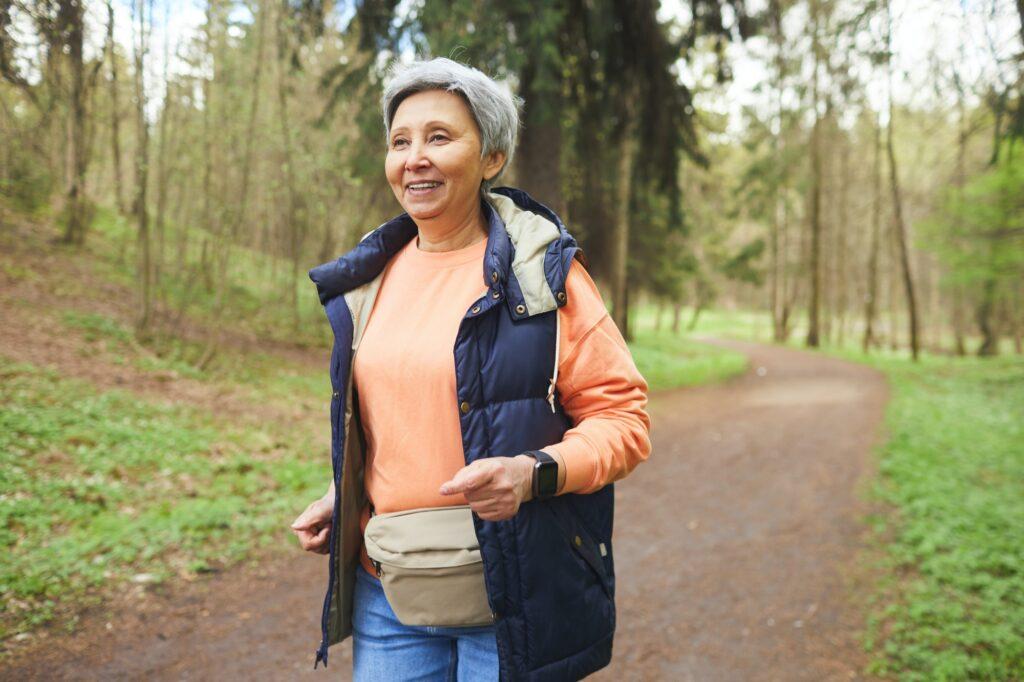 Active Senior Woman Running in Park